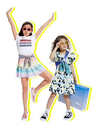 Two smiling kids wearing awesome clothes