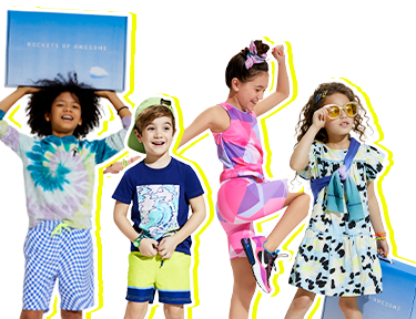 Four smiling kids wearing awesome clothes
